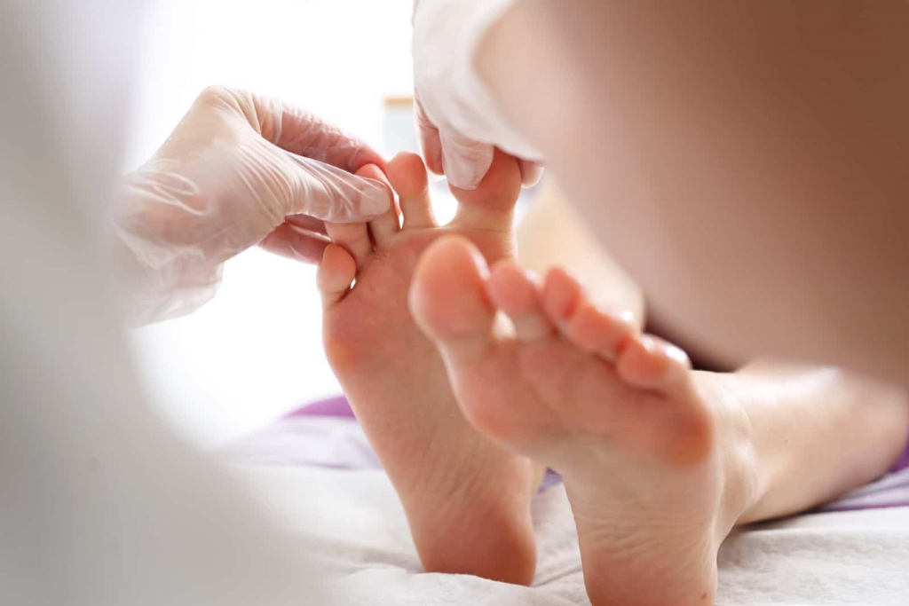 Doctor-inspecting-patients-foot